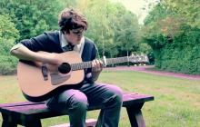 Richard Caddock playing guitar on a short walk...